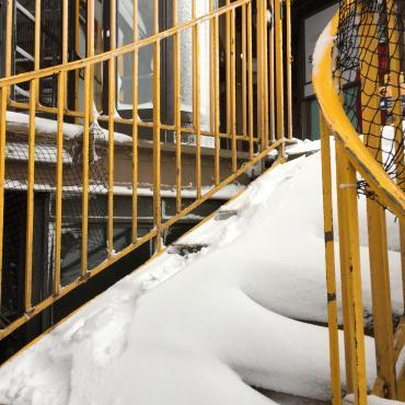 Eiffel tower stairs with snow